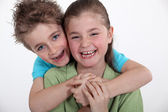 Brother and sister hugging. — Stock Photo