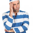 Man in convict costume - Stock Photo