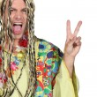 Enthusiastic man in a hippy costume - Stock Photo