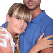 Stock Photo: Mhugging his wife