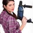 Woman holding an electric screwdriver — Stock Photo