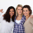 Three female friends waving — Stock Photo #16043331
