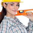 Craftswoman holding a level - Stock Photo