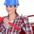 Female plumber ready for her next job — Stock Photo