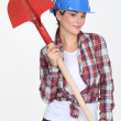 Female construction worker with a shovel — Stock Photo