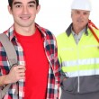Young man with a construction worker — Stock Photo