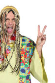 Enthusiastic man in a hippy costume — Stock Photo