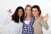 Three female friends waving — Stock Photo