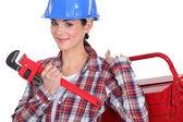 Female plumber ready for her next job — Stock Photo