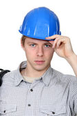 Electrician stood with coil over shoulder — Stock Photo