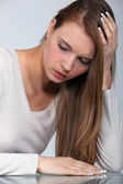 Blond woman with a headache — Stock Photo