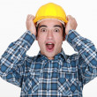 Young craftsman shouting with hands to hardhat - Foto Stock