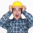 Young craftsman shouting with hands to hardhat - Stockfoto
