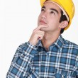 Stock Photo: Pensive manual worker.