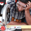 Man figuring out how to use saw — Stock Photo #16079157
