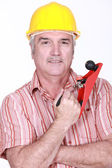 Man with hand tool — Stock Photo