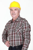 Portrait of man with yellow helmet — Stock Photo
