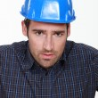 Stock Photo: Portrait of a worried tradesman