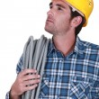A construction worker looking upwards - Foto Stock