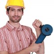Stock Photo: Man holding angle-grinder
