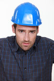Portrait of a worried tradesman — Stock Photo