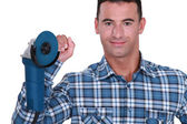 Yourselfer holding a sander — Stock Photo