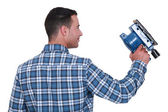 Man using powered sander — Stock Photo