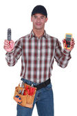 Man holding wire clipper and electrical current measure — Stock Photo