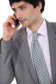 Portrait of successful businessman making telephone call — Stock Photo
