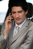 Businessman making phone call in his car — Stock Photo