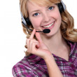 A blond woman with a headset on. — Stock Photo #16122011