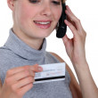 Woman on the phone with her credit card company — Stock Photo #16122053