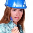 Woman in a hardhat with a clipboard — Stock Photo