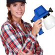 Woman holding a spray gun — Stock Photo