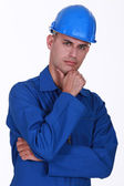 Portrait of a pensive tradesman — Stock Photo