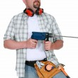 Man with a masonry drill — Stock Photo