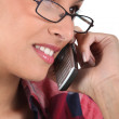 Womwith glasses on phone — Stock Photo #16162729