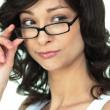 Stock Photo: Attractive wompeering over her glasses