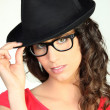 Woman wearing a black hat — Stockfoto