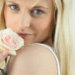 Blonde woman and a rose — Stock Photo #16168631