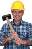 Tradesman holding a rubber mallet — Stock Photo