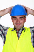 Relaxed construction worker — Stockfoto