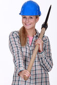 Woman with a pickaxe — Stock Photo