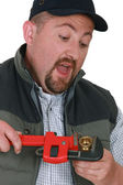 Plumber tightening nut with adjustable wrench — Stock Photo