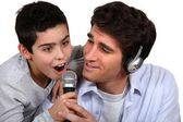 Father and son enjoying music together — Stock Photo