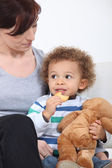 Woman and child with a teddy bear — Stock Photo