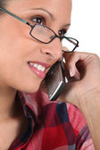 Woman with glasses on the phone — Stock Photo