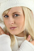 Beautiful young woman dressed in white — Stock Photo