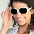 Woman wearing oversized sunglasses — Stock Photo #16181409