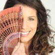 Young woman with a fan — Stock Photo #16181787